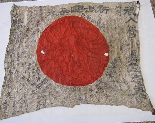 Japanese flag with a lot of Kanji... Is it from an aircraft?