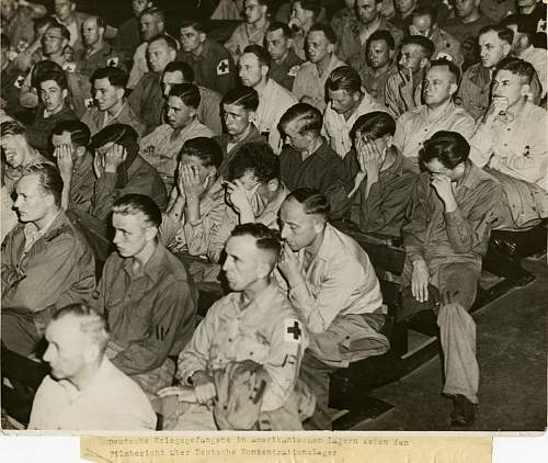 German soldiers react to footage of concentration camps, 1945.jpg