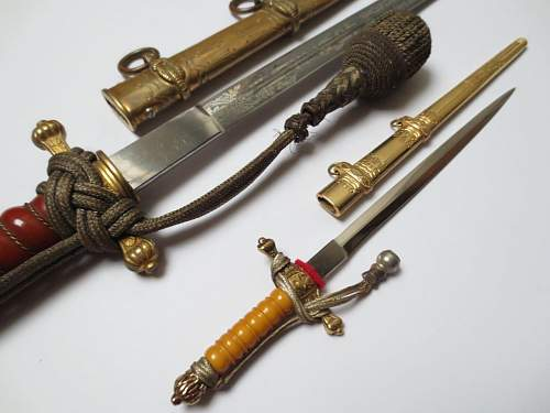 Big and small navy dagger