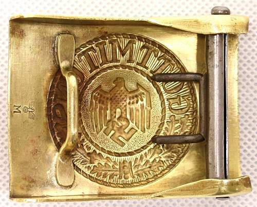 Need help : KM brass buckle.