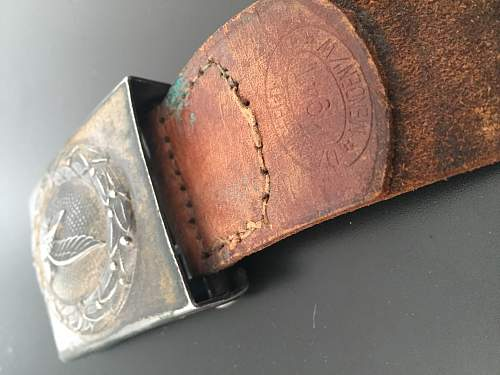 Unmarked steel buckle