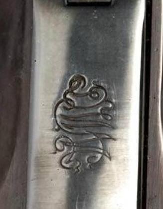 Dad's parabellum, odd etchings?