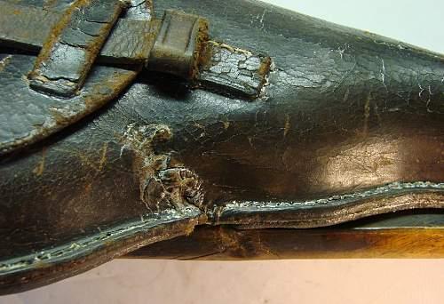 -original-1915-dated-holster-perhaps-bullet-hole-grazed-stock.jpg
