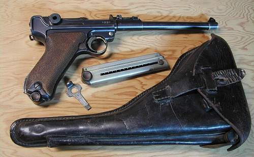 Click image for larger version.  Name:Copy of Best Holster ,Gun,Mag,tool on plywood.JPG Views:1854 Size:207.9 KB ID:67005