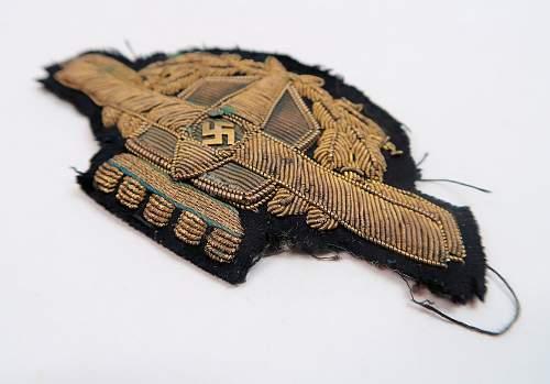 unidentified insignia - perhaps a private airline visor cap wreath & swastika cockade?