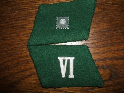 Unknown collar tabs
