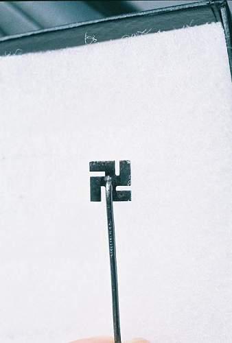 Need id on this Swastika Stick pin