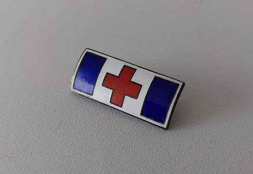 Enameled red cross pin