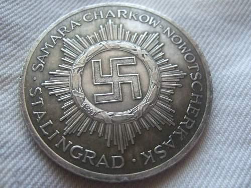 Original or fake? 64th Motorcycle Battalion 14th Panzer Division medal.