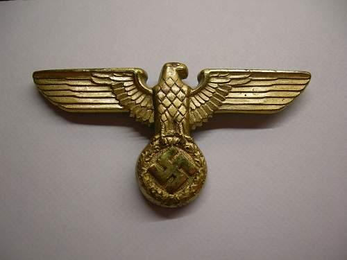Gold political eagle insignia