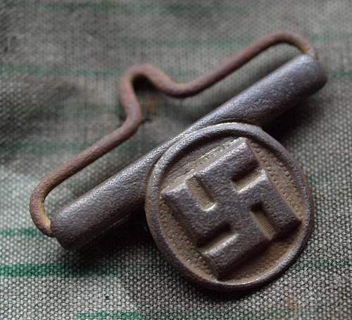 interesting suspender hook with swastika