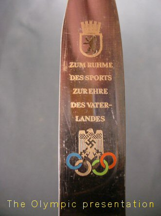 Olympic badge for sale.