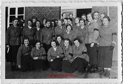 What uniforms are these women wearing with black armband and cuff titles