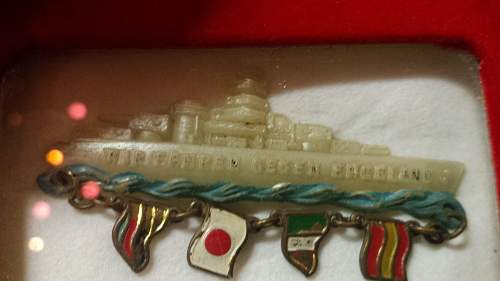 Interesting naval badge - 4 axis powers and a battleship in plastic!