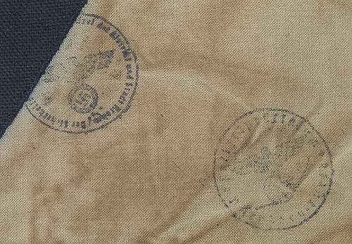 Need help with I.D. of stamps on black triangle armband