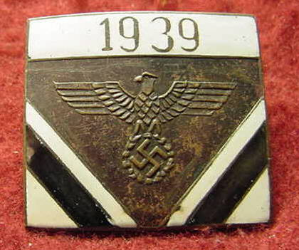 Pins/Badges Marked Wolfschanze on reverse.  Can anyone help identify/authenticate?