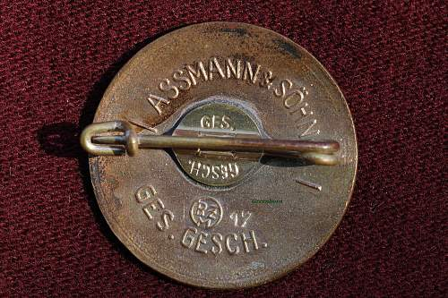 Rare Assmann stamped license # Party badge