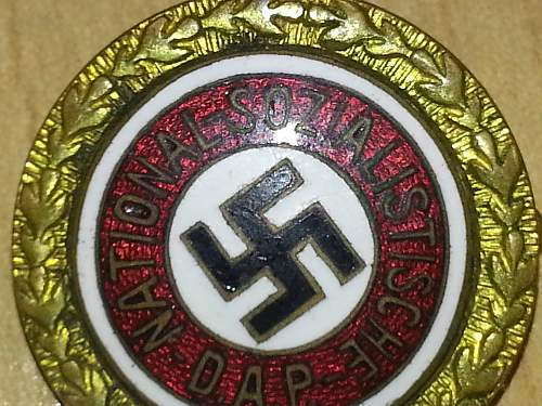 Gold party badge
