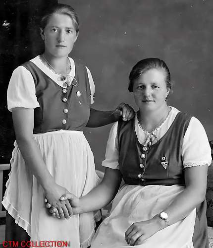 Photo of Austrian sisters wearing National Socialist pins and necklace