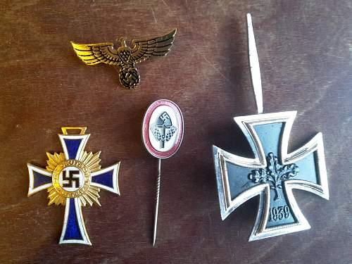 Found multiple badges and pins.
