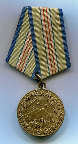 Click image for larger version.  Name:Medal for Defense of the Caucasus obverse.jpg Views:50 Size:120.7 KB ID:156384