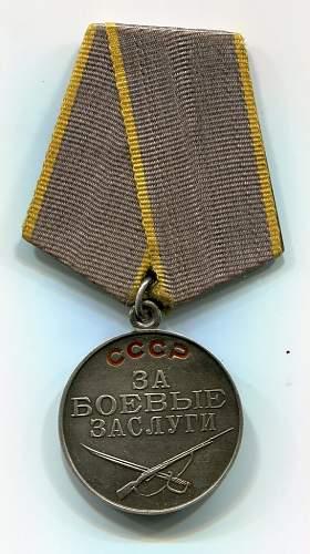 Click image for larger version.  Name:Yuriy Kosarev, Medal for Combat Service, obverse.jpg Views:107 Size:145.8 KB ID:96606