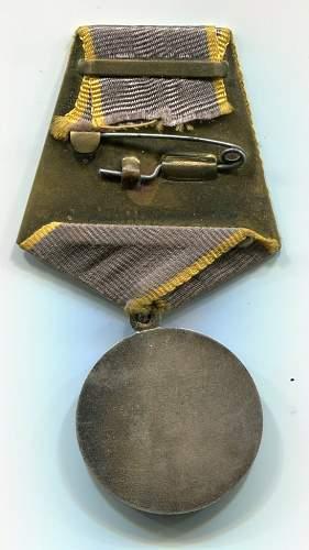 Click image for larger version.  Name:Yuriy Kosarev, Medal for Combat Service, reverse.jpg Views:100 Size:125.2 KB ID:96607