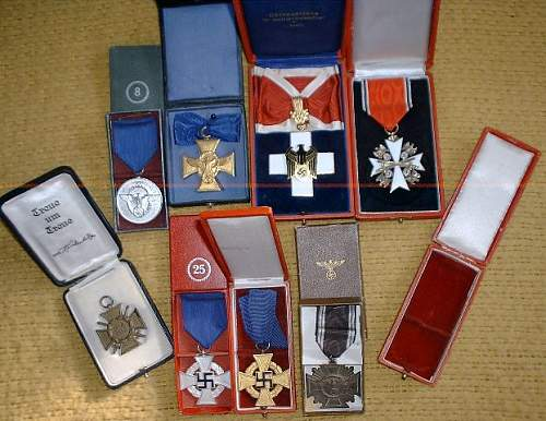 Click image for larger version.  Name:medals cased, open.JPG Views:36 Size:72.9 KB ID:1002218