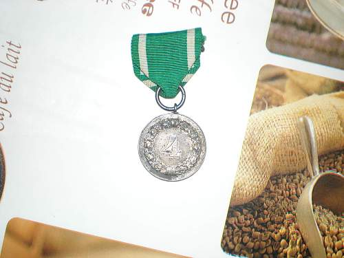 4 year service in the wehrmacht medal with green ribbon