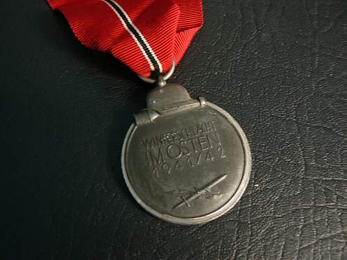 Click image for larger version.  Name:East Front Medal_back.jpeg Views:68 Size:91.5 KB ID:109252