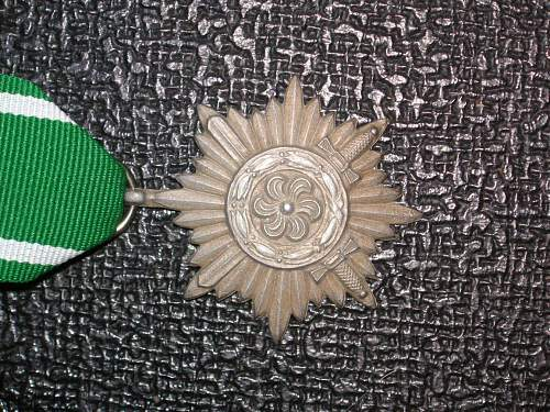 2nd class ostvolk in bronze with swords (flat reverse and no rope around the flower). wartime,57 or just a repro?