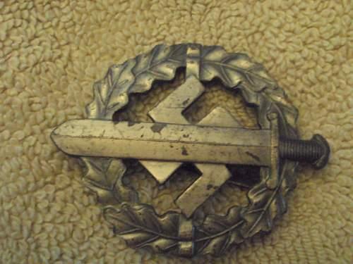 SA sports badge in silver