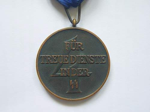 Click image for larger version.  Name:SS Four year service medal 002.jpg Views:54 Size:137.9 KB ID:143450