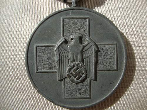 Volkspflege medaille and 8 mm pin