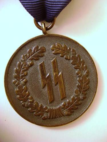 SS 4 year long service medal.