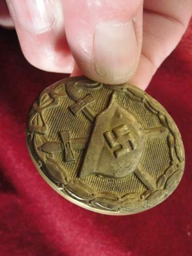 Scarce stamped gold badge