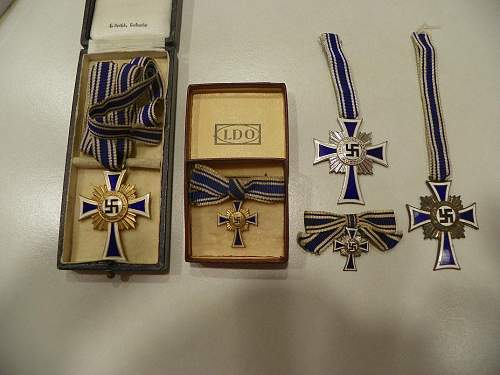 My new cased Ehrenkreuz der Deutschen Mutter in gold one uncased silver and small one in box in gold