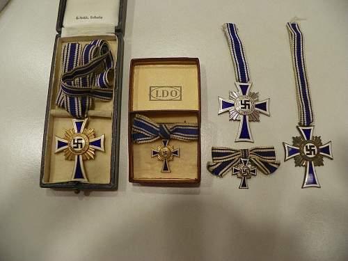 My new cased Ehrenkreuz der Deutschen Mutter in gold one uncased silver and small one in box in gold