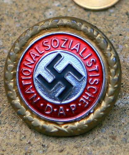 I think this is an authentic NSDAP Gold party badge sales sample.....