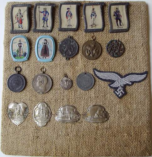 These WWII German medals, tinnies, insignia, etc. walked into my office in a baggy. A mini collection.
