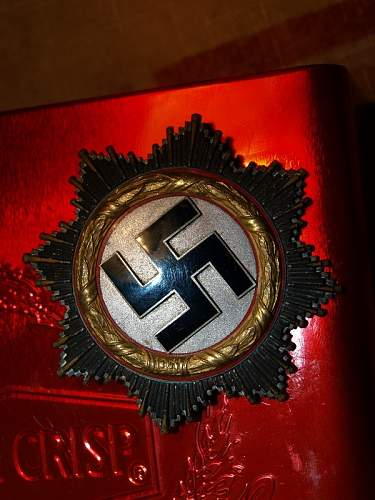 Deutsche Kreuz in Gold and NSDAP awards.