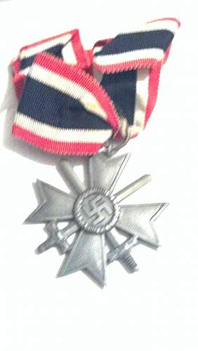 Geman misc lot of medals and stuff that i need help with