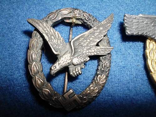 Two mystery badges. Vet cut out Swastika or Fake?