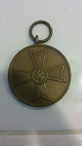 Click image for larger version.  Name:medal front.jpg Views:438 Size:222.5 KB ID:371851