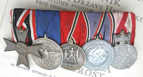 Can you help me find the owner of this medal bar?