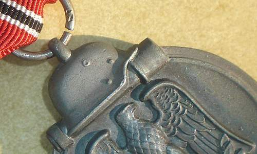 Ostfront Medaille  Makers Mark? What do you Think?