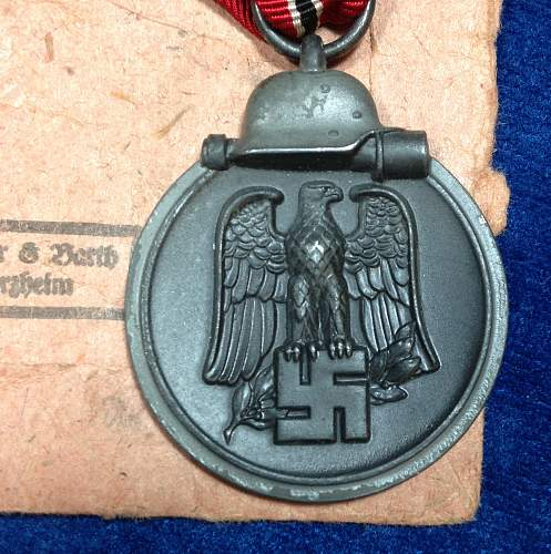 Click image for larger version.  Name:Ostmedaille 10 Obverse w packet.jpg Views:66 Size:324.7 KB ID:436973
