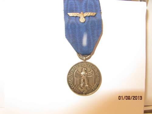 Treue Dienst   Wehrmacht 4-yr  medal real or fake