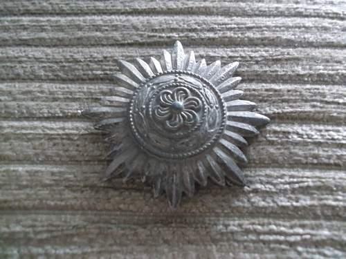 Is this a German Award? Ostvolkmedaille 1er Klasse in Silber.