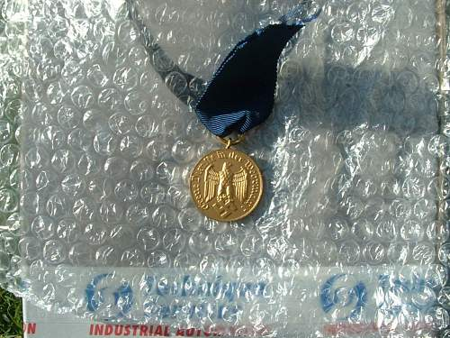 Click image for larger version.  Name:12y service medal front.jpg Views:45 Size:170.3 KB ID:49277